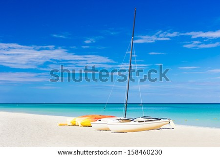 Sailing boats at the famous Varadero beach , Caribbean sea in Cuba - stock photo