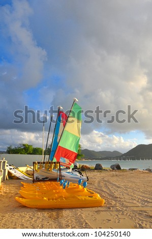 Sailing boats drawn up on the beach in the caribbean.