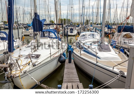 Sailing Boats in a Marina in Makkum, Friesland, The Netherlands - stock photo