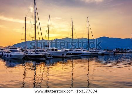 Sailing boats in marina at sunset. Tivat. Montenegro - stock photo