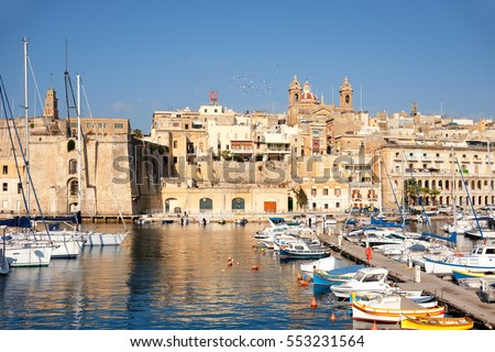 Sailing boats on Senglea marina in Grand Bay, Valetta, Malta, on a bright sunny morning