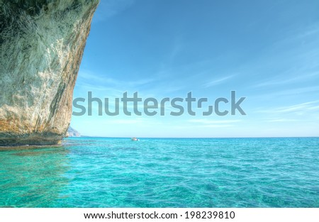 sailing by the cliff in hdr tone - stock photo