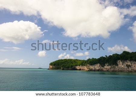 Sailing by the end of Guadeloupe - stock photo