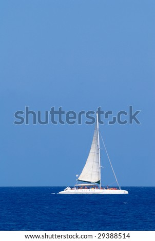 Sailing catamaran at an open Mediterranean Sea