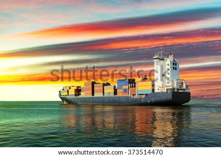 Sailing container ship at sunset on sea. - stock photo