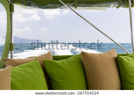 sailing, leisure, travel and tourism concept - ocean view from board of sailing boat or yacht - stock photo