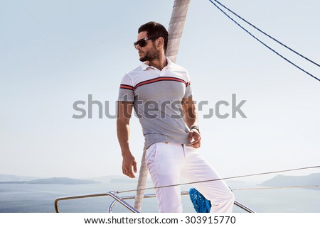Sailing man on boat in ocean - stock photo