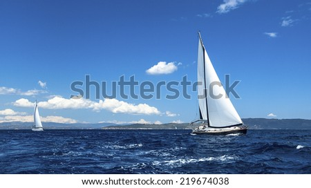 Sailing on a calm sea. Boat race. Luxury yachts. - stock photo
