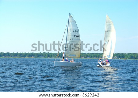 Sailing on Muskegon Lake - Sailing is a favorite pastime for summer vacationers on Muskegon Lake in Michigan, USA. - stock photo