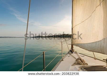 Sailing on the Balaton-lake with Tihany panorama - stock photo