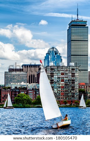 Sailing on the Charles river on a windy day with the Boston skyline in the background - stock photo