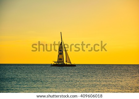 Sailing on the horizon at sunset in the Caribbean Dominican Republic