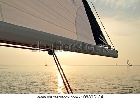 Sailing on the IJsselmeer at sunset in the Netherlands