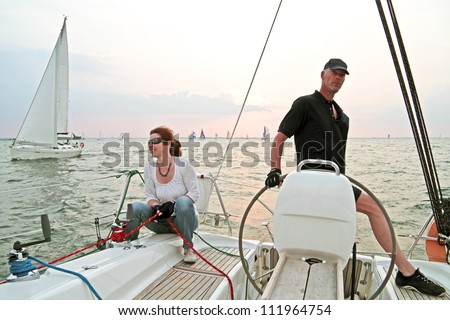 Sailing on the IJsselmeer in the Netherlands at sunset - stock photo