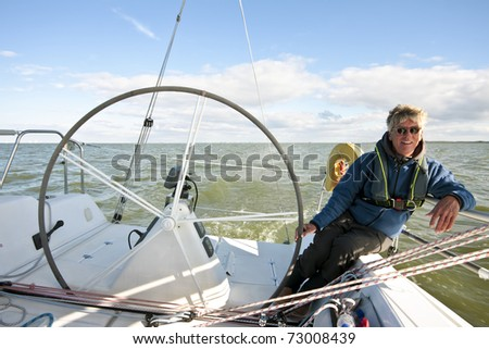 Sailing on the IJsselmeer in the Netherlands on a beautiful sunny day