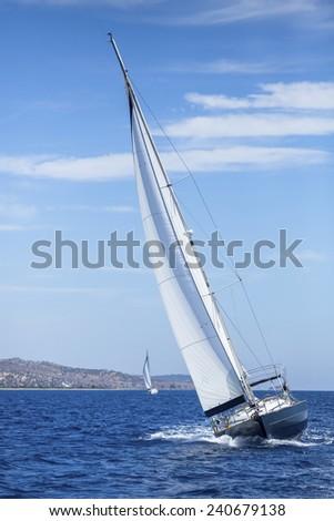 Sailing, racing yachts on the high seas. Luxury yachts. - stock photo