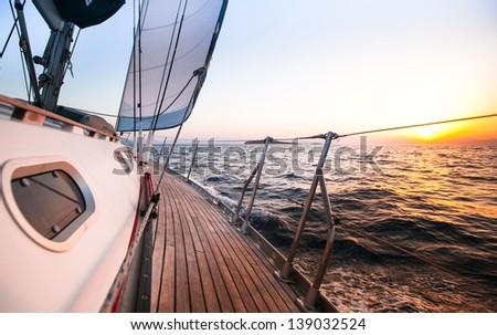 Sailing regatta in Greece, during sunset. - stock photo
