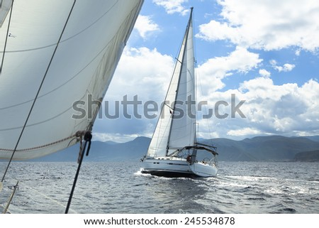 Sailing regatta in inclement weather. Sailboats. Yachting. - stock photo