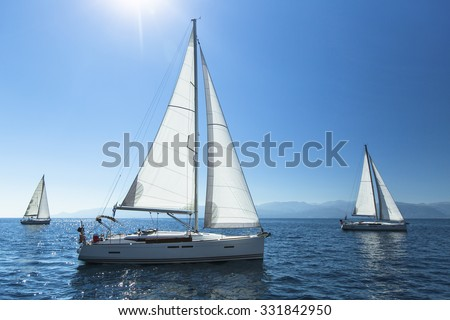 Sailing regatta. Sailing in the wind through the waves. Luxury yachts. - stock photo