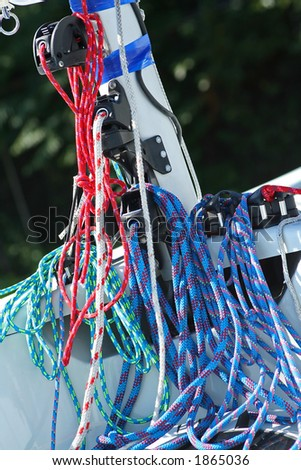 Sailing rigging.  Blocks and colour cords.  Detail of yacht - stock photo