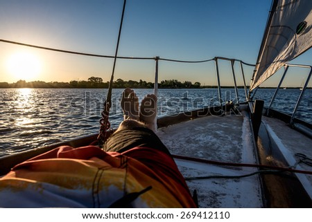 Sailing river vivid colors, Sunset point of view.. - stock photo
