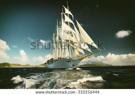 Sailing ship and beautiful wave.  Toned image and blur. Retro style postcard. Sailing. Yachting. - stock photo
