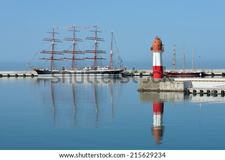 Sailing ship and lighthouse. Series of yachts and ships - stock photo