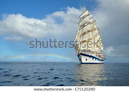 Sailing ship and rainbow - stock photo
