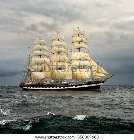 Sailing ship and the stormy sky. Sail. Yachting. Sailing - stock photo