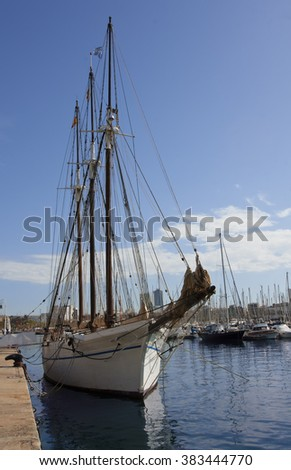Sailing ship and yachts in the harbor of Barcelona. Spain. - stock photo