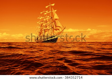 Sailing ship in a beautiful golden sunset.  Instagram effect. Sailing. Yachting - stock photo