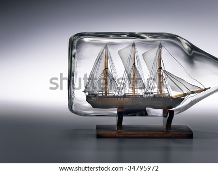 Sailing ship in bottle - stock photo