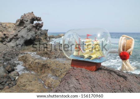 Sailing Ship in the Bottle near the Ocean