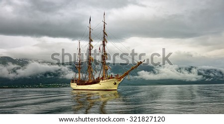 Sailing ship in the north of Norway. Yachting. Sail