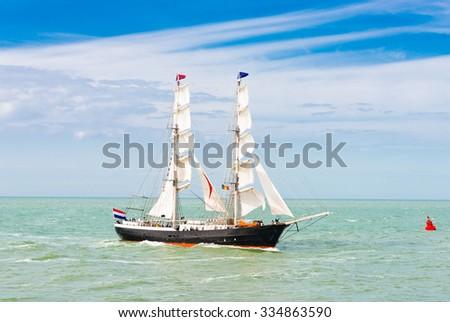Sailing ship in the sea - stock photo