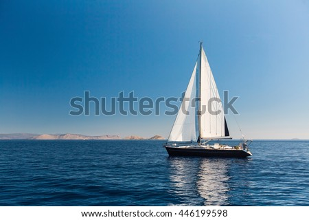 Sailing ship luxury yacht with white sails in the Sea.  - stock photo