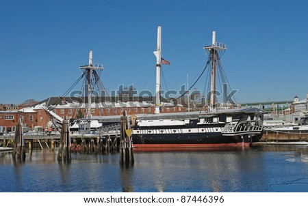"sailing ship named ""USS Constitution"" anchoring in Boston (Massachusetts, USA) at winter time in sunny ambiance - stock photo"