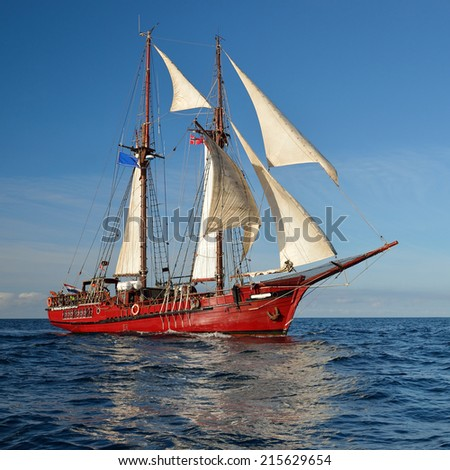 Sailing ship on the background of the beautiful sky and sea - stock photo