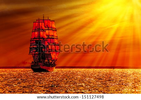 Sailing ship on the sea at sunset skyline. - stock photo
