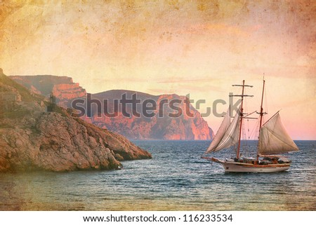 sailing ship sails along the rocky shore, vintage style - stock photo