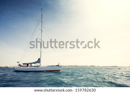 Sailing ship yachts with white sails - stock photo