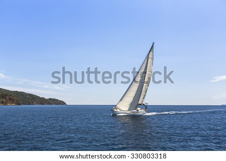 Sailing ship yachts with white sails in the Mediterranean Sea. - stock photo