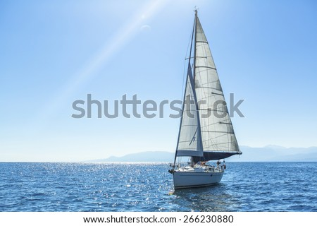 Sailing ship yachts with white sails in the open Sea. Luxury boats. - stock photo