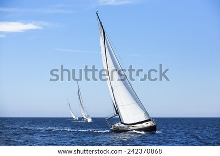 Sailing ship yachts with white sails. Luxury yachts.  - stock photo