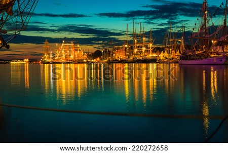 Sailing ships in the harbour during the tall ships races Bergen, Norway. Night view - stock photo