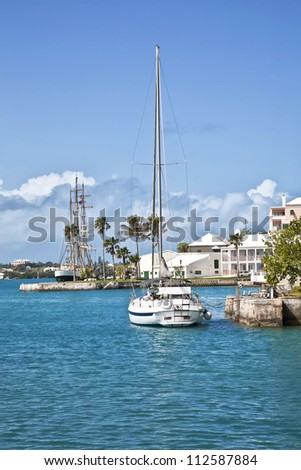 Sailing ships tied up on the waterfront of the town of St. George's, Bermuda.