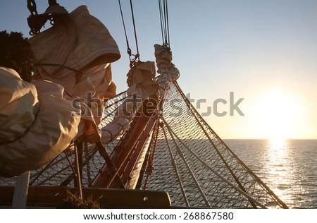 Sailing  to the sunrise. - stock photo