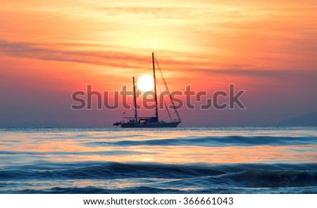 Sailing yacht at sunset in the tropical sea
