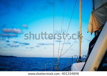 Sailing yacht boat on ocean water at sunset. a wonderful view of the sea from the yacht