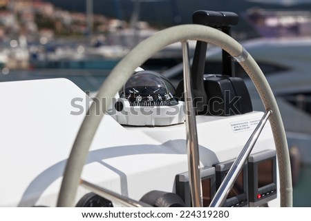 Sailing yacht control wheel and implement. Horizontal shot without people - stock photo